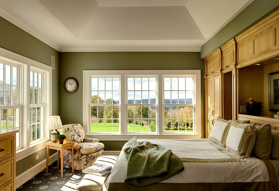 Traditional bedroom in green and white with large windows [Design: Crisp Architects]