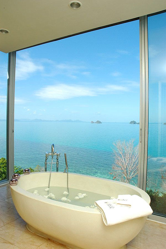 Tropical tub with a sea view  Spectacular Bathroom Design with a View Tropical tub with a sea view