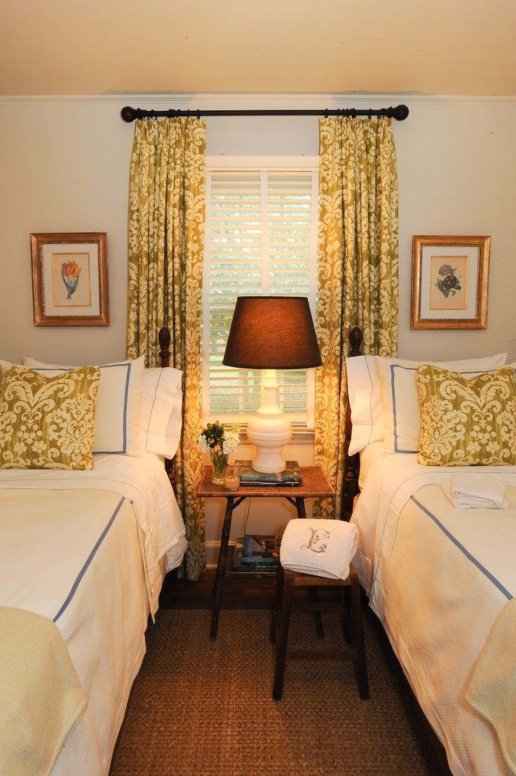 Twin beds in small guest room with matching curtains and pillows