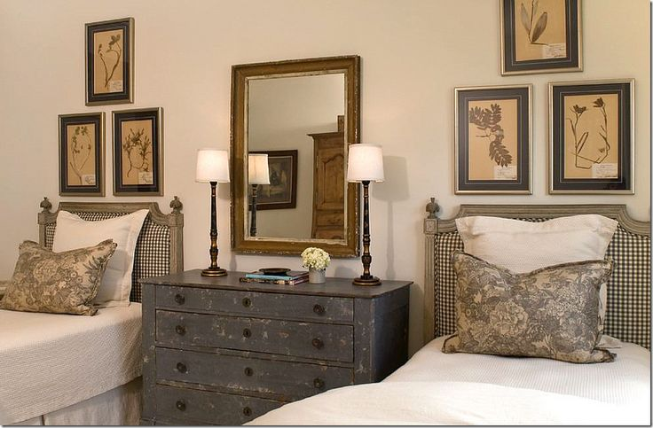 Twin beds with rustic dresser between them