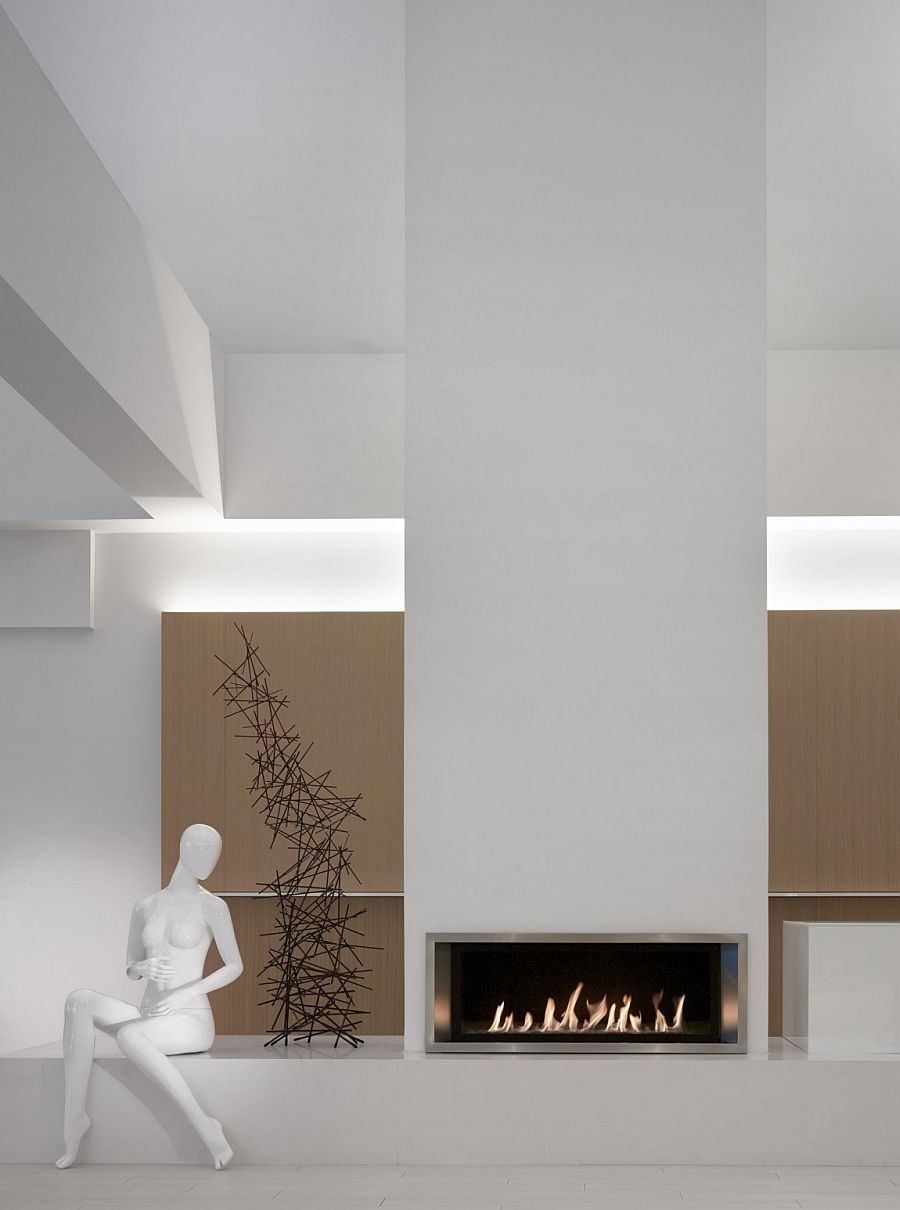Two story fireplace with contemporary charm in pristine white