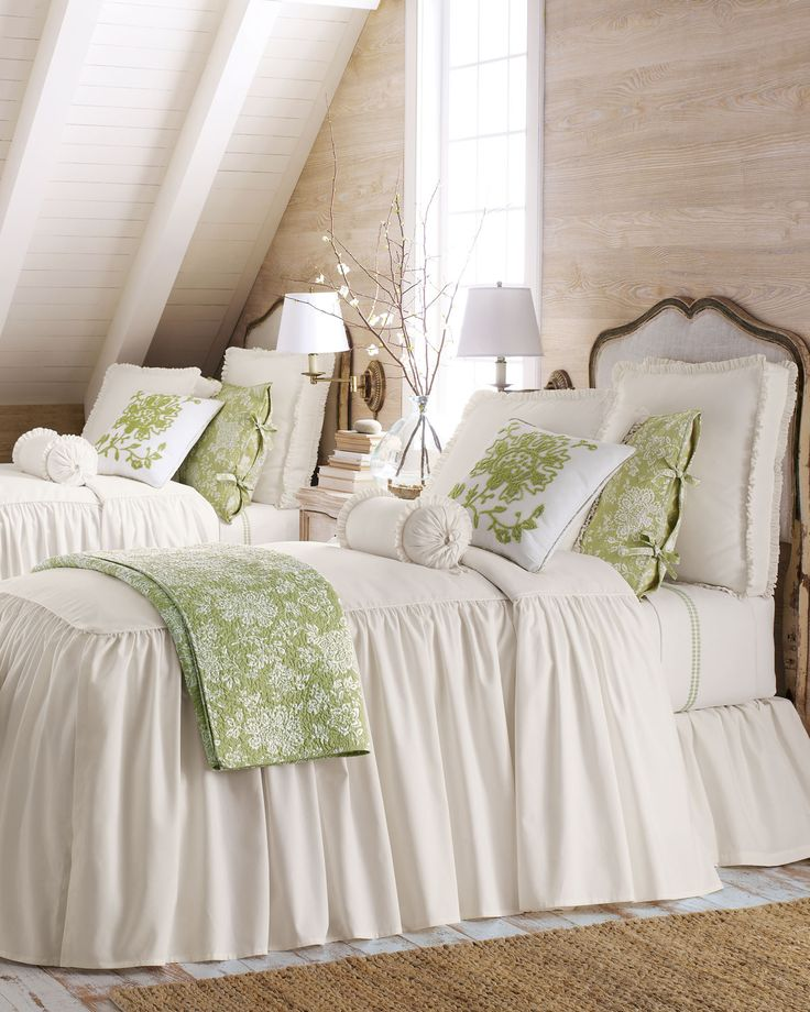 Two twin beds featuring Legacy Home Hampton bed linens