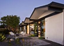 Unassuming patio design in gravel and concrete