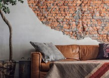 Unfinished and exposed brick wall in the living room 217x155 Antique Chic Makeover: Vintage Apartment Acquires Curated Industrial Sheen