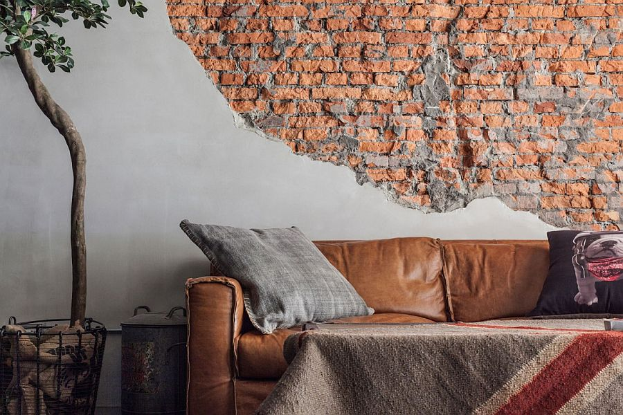 Unfinished and exposed brick wall in the living room