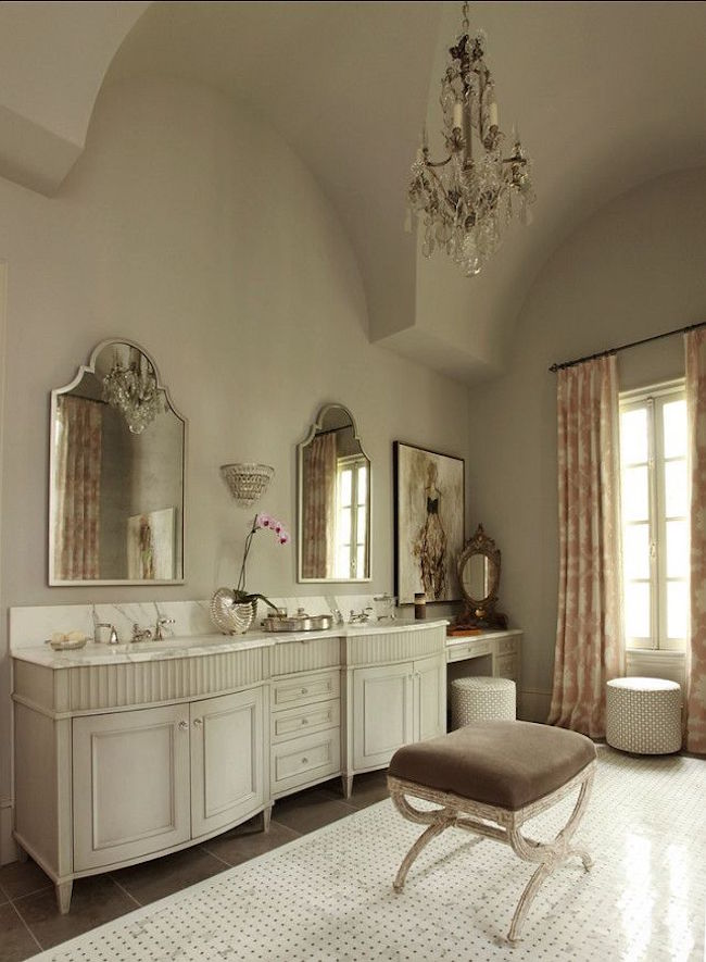 Upholstered vanity stool in elegant bathroom
