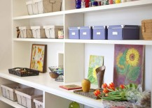 Vases-and-baskets-of-supplies-on-a-large-bookshelf-217x155