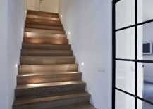 Very small light fixtures on each wall along a wood staircase 217x155 15 Modern Staircases with Spectacular Lighting