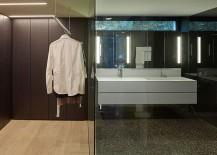 Walk-in closet and contemporary bathroom in dark stone