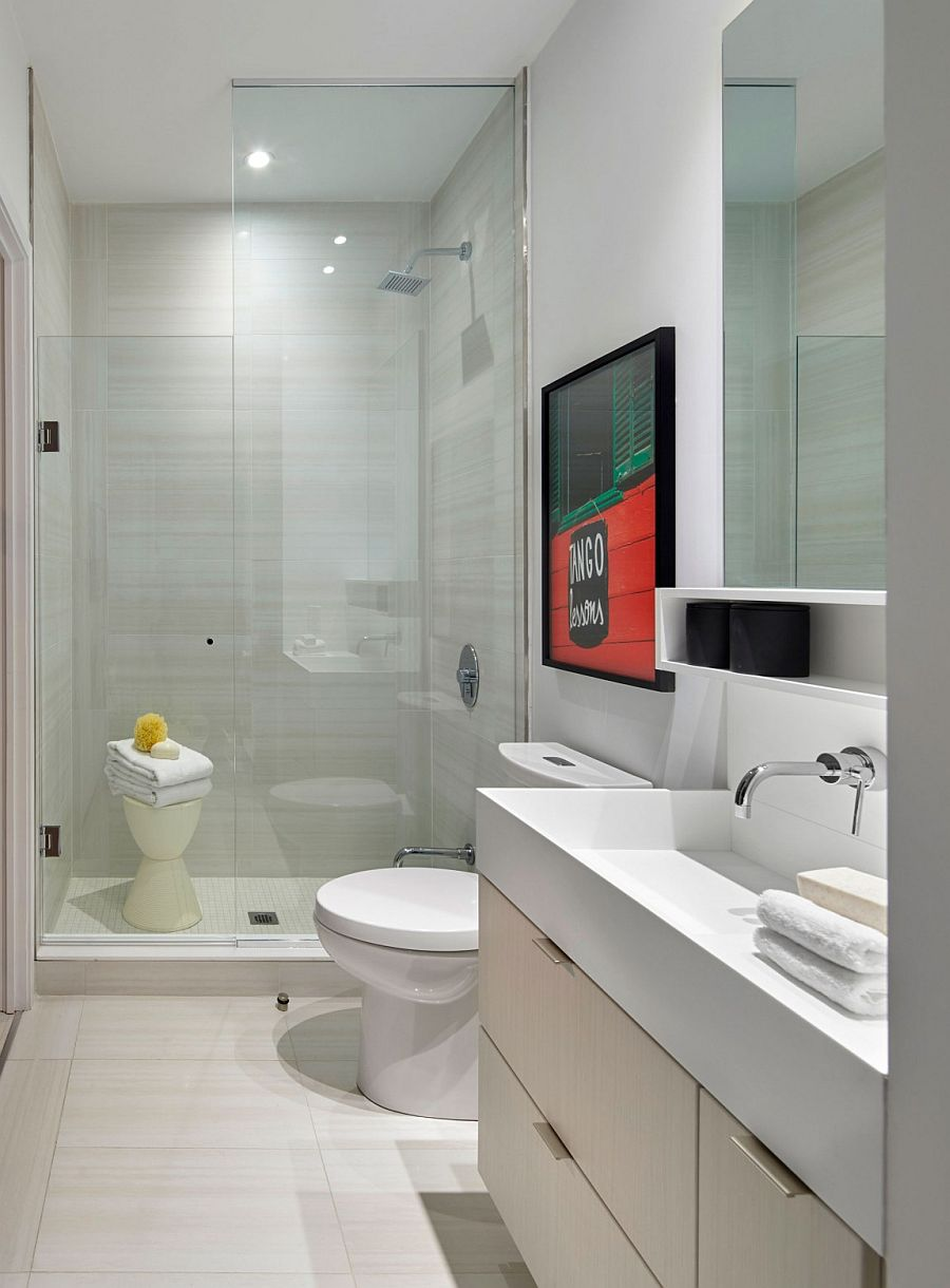 Wall art brings color to the posh, contemporary bathroom