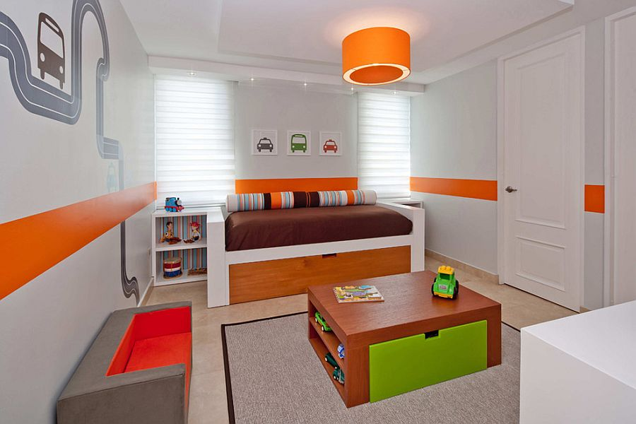 Wall decal and pendant usher in orange into this toddler room [Design: alvarez-diaz villalon]