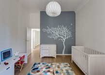 Wall-mural-blends-into-color-scheme-of-the-nursery-while-rug-brings-geometric-class-217x155