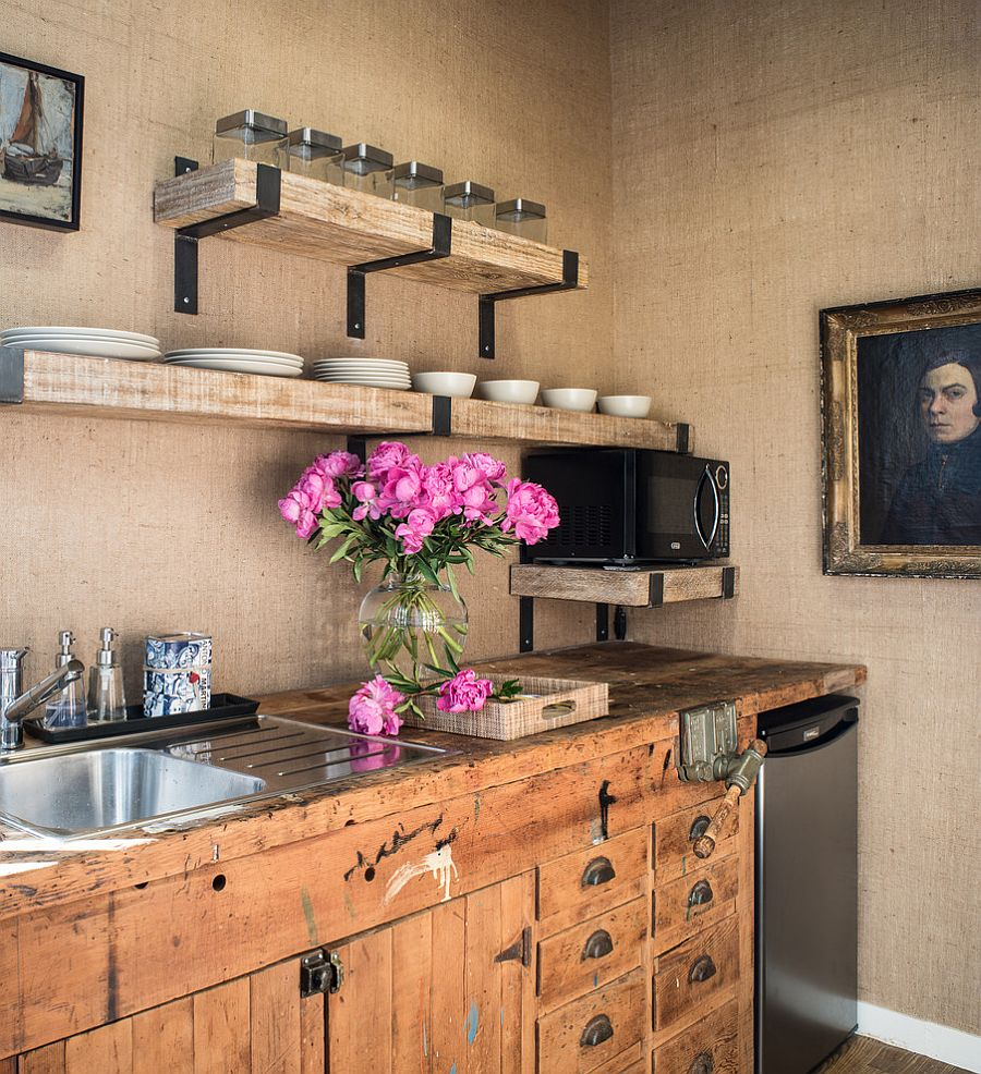 Walls covered in burlap and vintage kitchen cabinets shape the lovely kitchen