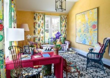 Walls in yellow bring texture and coziness to the eclectic home office full of color