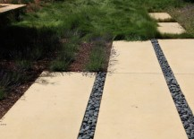 Weed barrier fabric on a garden pathway 217x155 The Pros and Cons of Preventing Weeds with Landscape Fabric