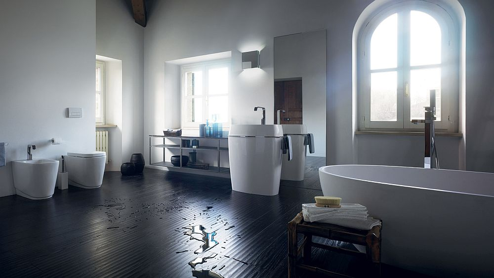 White bathroom fixtures stand in contrast to the dark wooden floor