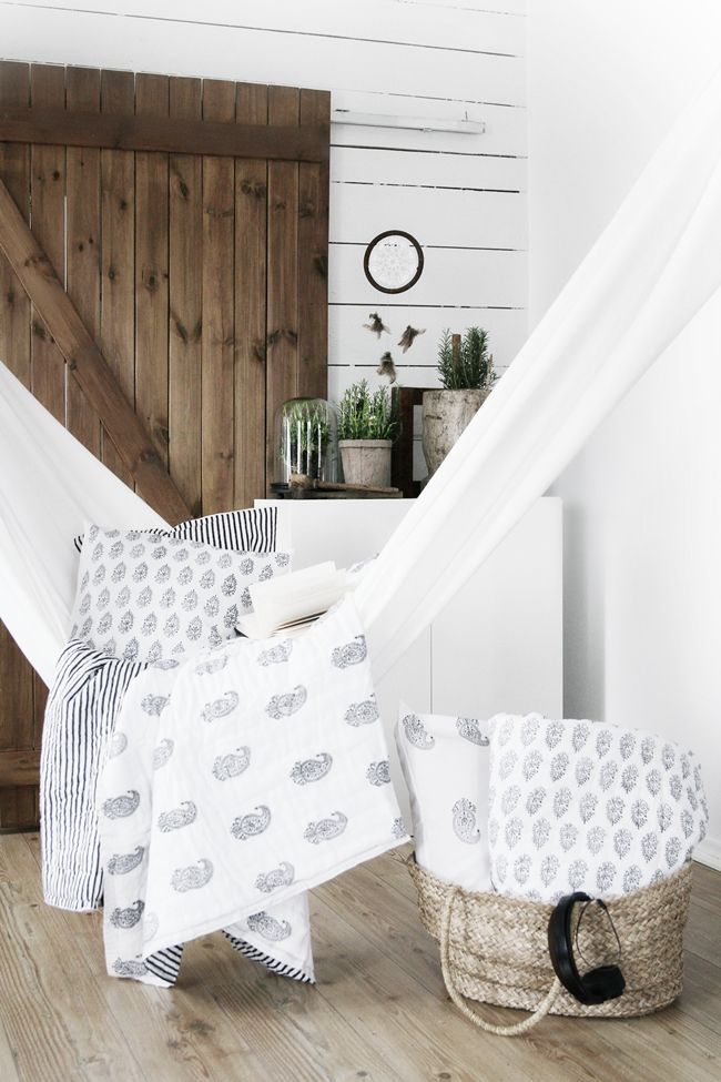 White hammock with comfy blankets and pillows