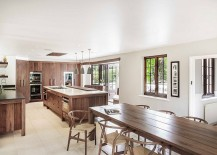 White kitchen with cabinets, island and workstation in wood