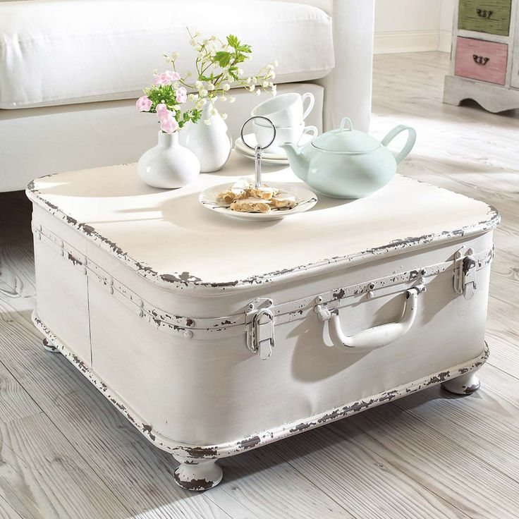 White shabby chic suitcase with feet added to it