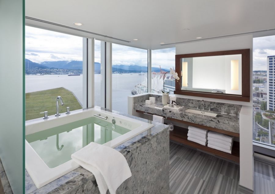 Window-filled bathroom with a sea view  Spectacular Bathroom Design with a View Window filled bathroom with a sea view