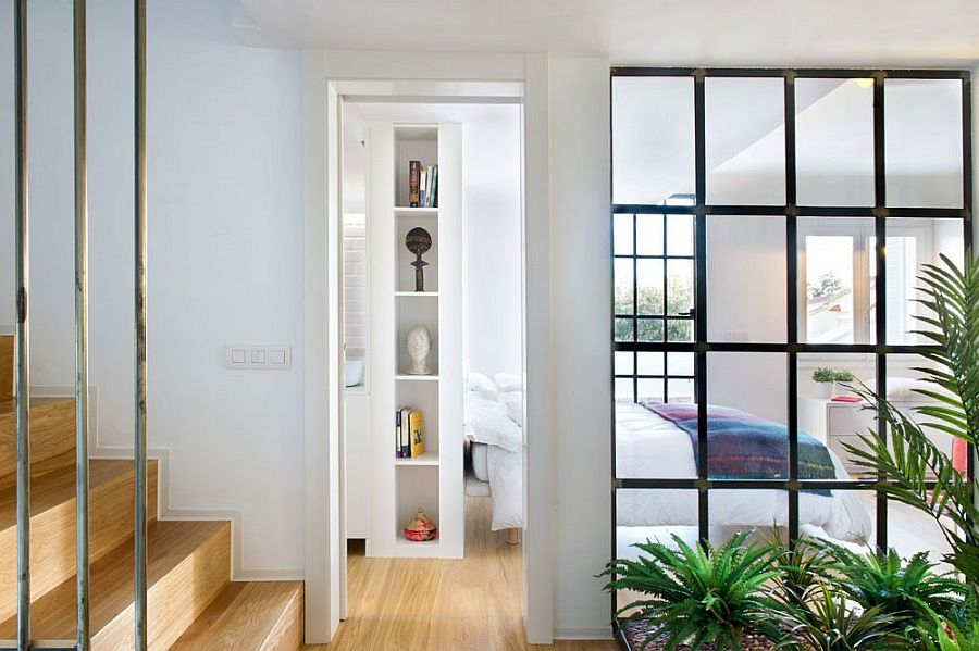 Windows with dark metal frame borrow from industrial style