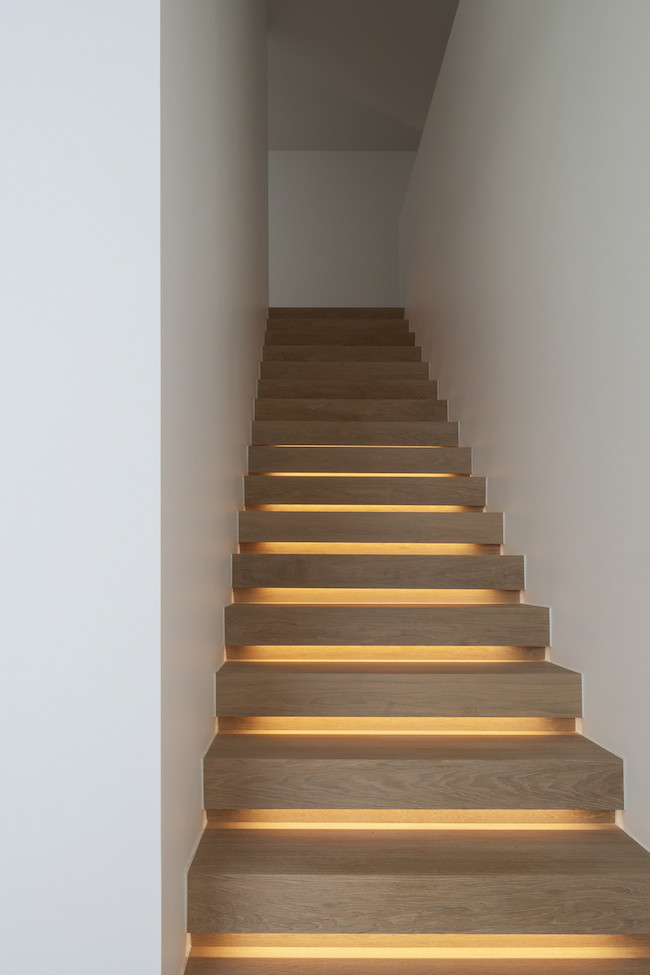 View In Gallery Wood Staircase With Lighting That Creates A Soft Glow