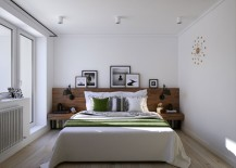 Wooden headboard and bedside tables along with sconce lighting made for book lovers