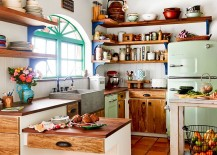 Wooden shelves and cabinet doors bring farmhouse charm to the eclectic kitchen
