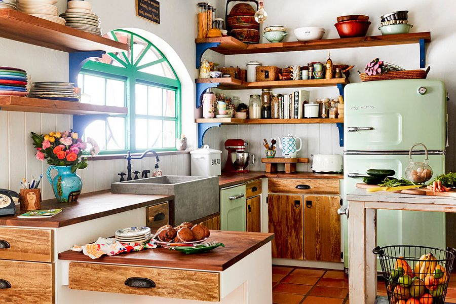 Wooden shelves and cabinet doors bring farmhouse charm to the eclectic kitchen [From: Rikki Snyder Photography]