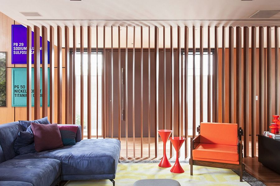 Woodens slats allow you to switch between privacy and connectivity in the TV room