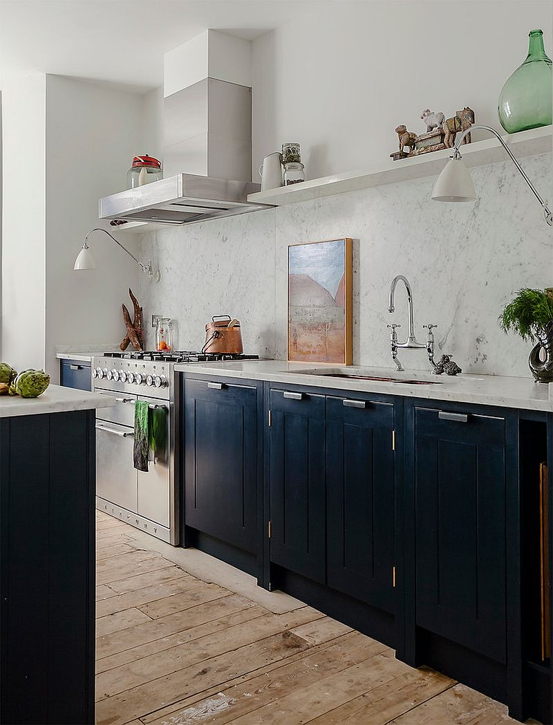 Worktops in Carrara Marble and lovely painted cabinets in the trendy kitchen [Design: British Standard by Plain English]