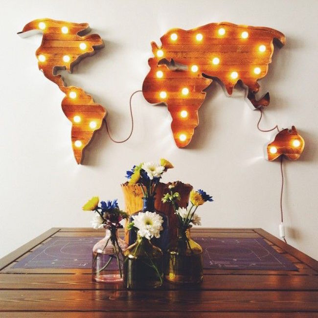 World map marquee sign hung on the wall