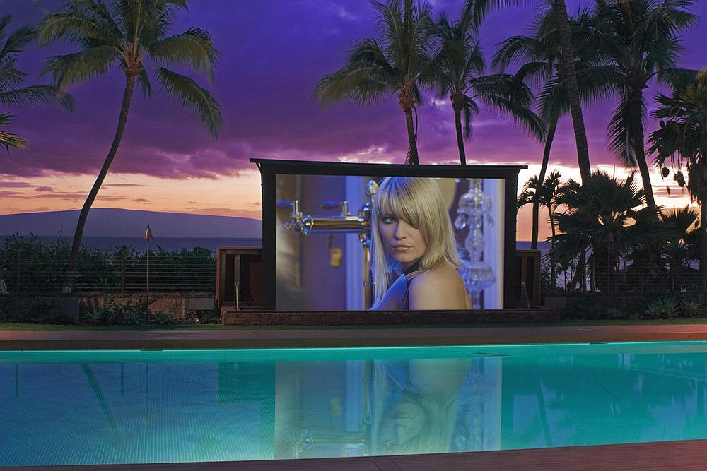 20-foot high-tech poolside screen with weather-sensitive features shapes a stunning outdoor theater [Design: VIA – San Francisco]
