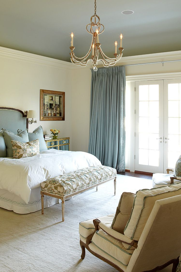A classic chandelier can make all the difference in the stylish bedroom [Design: Wright Building Company / Suzanne Kasler]