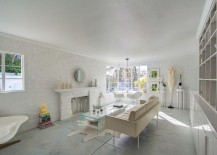 All-white contemporary living room with painted brick wall [Design: Courtney Jones - Carmel Realty Company]