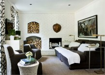 Antique additions in the fireplace add to the exclusivity of the media room [Design: Melanie Turner]