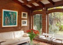 Arched window design brings classic elegance to the living room with brick walls [Design: Carolina Katz + Paula Nuñez]