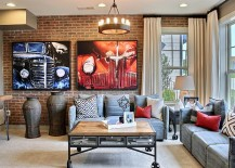 Art work, coffee table on wheels and vintage decor additions add texture to the small room