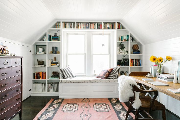 Attic office space with great shelving around window  15 Bright Attic Spaces for an Office or Studio Attic office space with great shelving around window