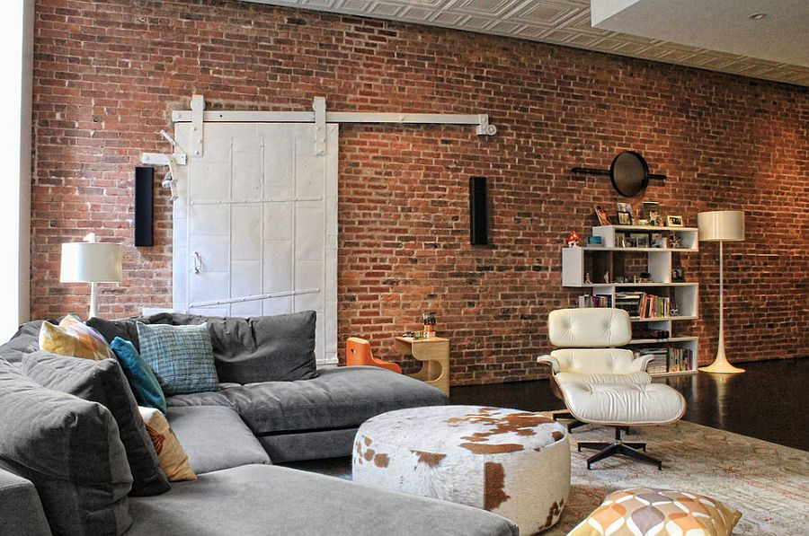 Barn door adds a quirky visual to the cool living room [Design: Tamara H Design]
