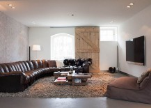 Barn door adds rustic touch to the cozy, contemporary living room