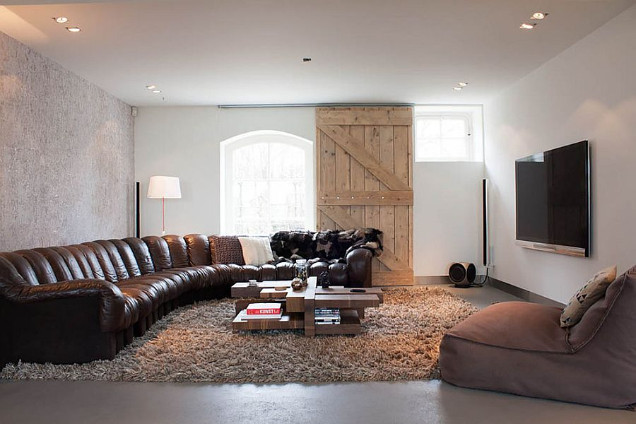 Barn door adds rustic touch to the cozy, contemporary living room [From: Louise de Miranda]
