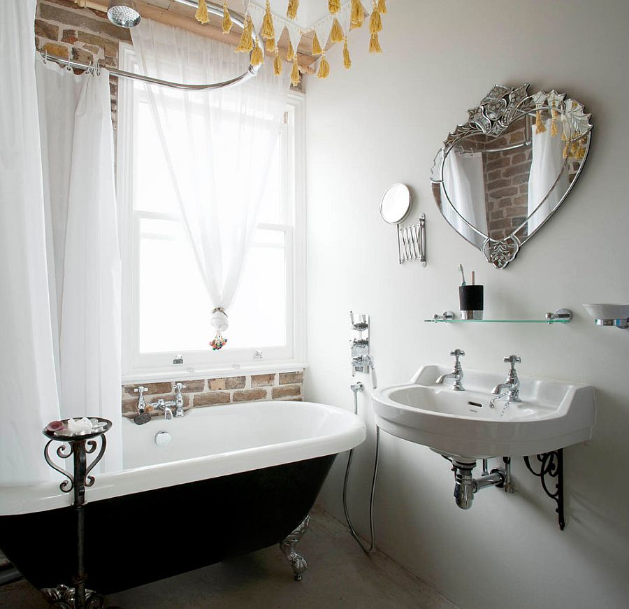 Bathroom with brick wall, white sheer curtains and vintage bathtub in black [Design: MDSX Contractors]