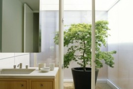 Bathroom with walkout to a bright courtyard  16 Minimal Courtyards with Just a Hint of Nature Bathroom with walkout to a bright courtyard