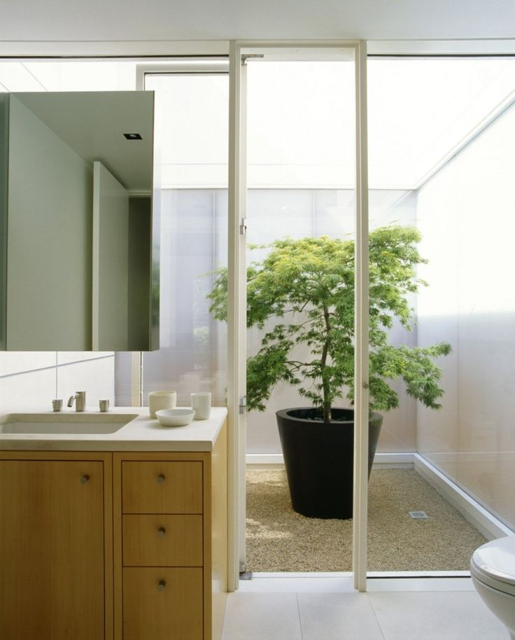Bathroom with walkout to a bright courtyard