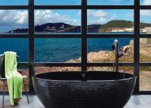 Beach style bathroom fetaures a sizzling stone black bathtub