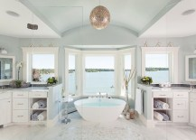 Beach style bathroom offers a relaxing dip and a fabulous view