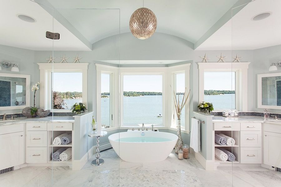 Beach style bathroom offers a relaxing dip and a fabulous view [Design: Roomscapes Luxury Design Center]