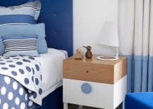 Beach style bedroom in white and blue with light wooden tones