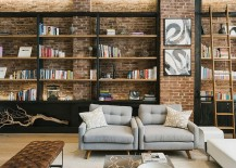 Beautiful bookshelves add to the industrial style of the living room [Design: Raad Studio]